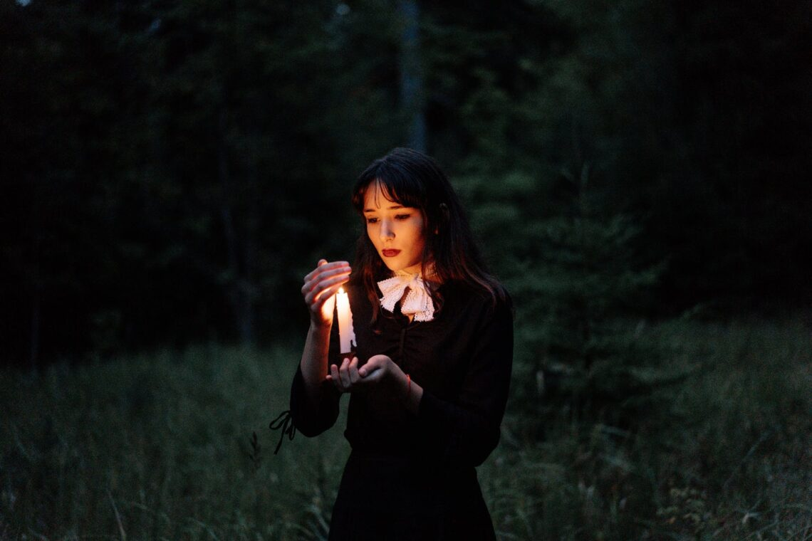 woman in black long sleeve shirt standing on green grass field